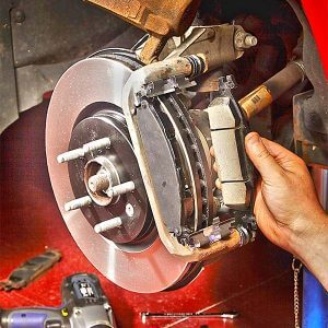 Repair shop replacing car's brake pads